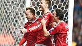 Bendtner back as Denmark clinch playoff spot with Romania draw