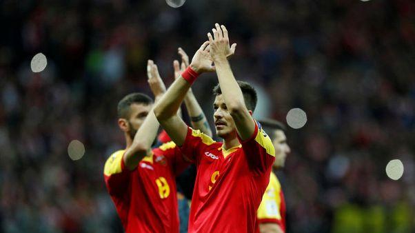 Lewandowski helps Poland seal World Cup berth with Montenegro win