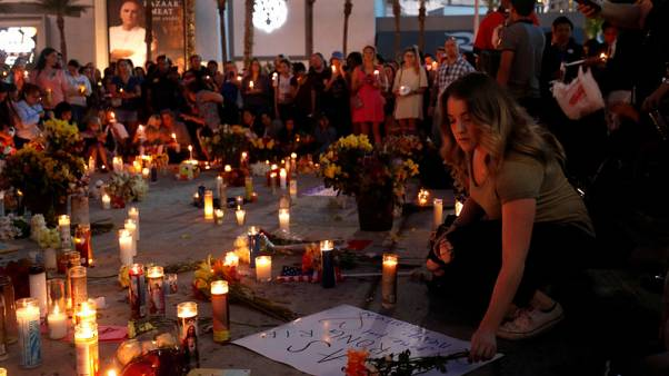 Therapy dogs comfort Las Vegas victims as massacre remains mystery