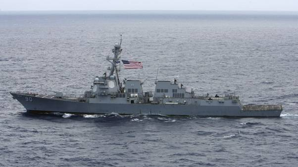 Exclusive - U.S. warship sails near disputed island in South China Sea: U.S. officials