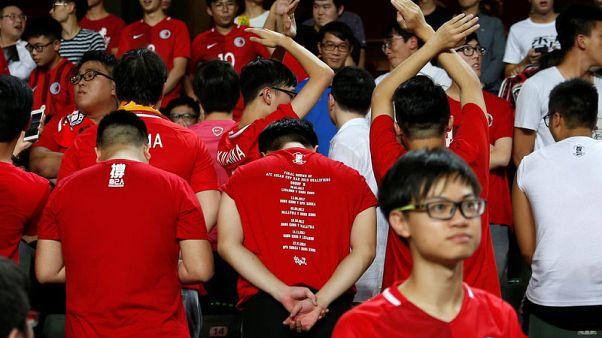 Hong Kong fans jeer China's national anthem