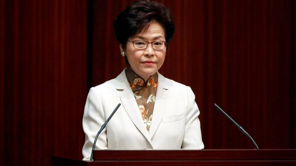 Hong Kong leader says to cut taxes, ease housing crunch in maiden policy address