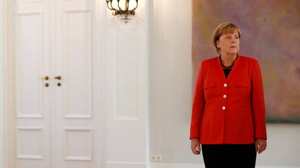 Merkel names refugee expert as foreign policy adviser