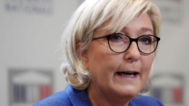 With far-right in turmoil, France's Le Pen softens anti-EU stance