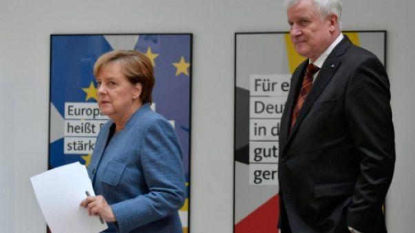 Scrutin régional en Allemagne: la semaine compliquée de Merkel en quête de majorité