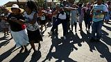 Crowds hurl abuse at South African cannibalism suspects