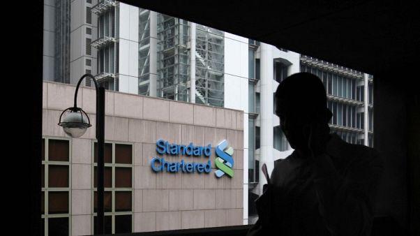 HK regulator drops case against StanChart, UBS over 2009 IPO-sources