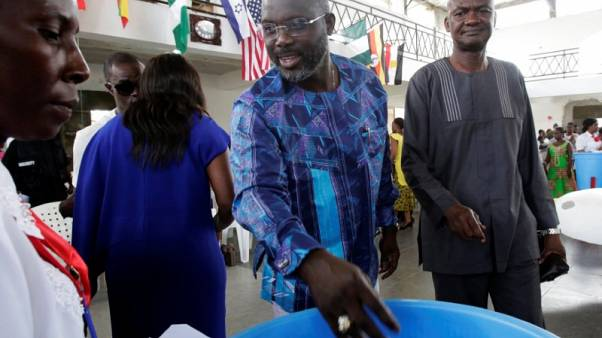 Soccer star Weah and VP Boakai near Liberia presidential run-off