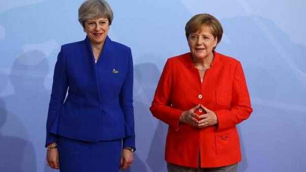 Britain, Germany committed to Iran nuclear deal - May's office
