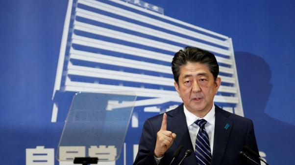 Japan ruling bloc heads for big election win despite voter distaste for PM Abe - poll