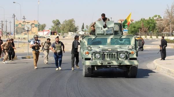 Iraq says captures positions south of Kirkuk including airbase