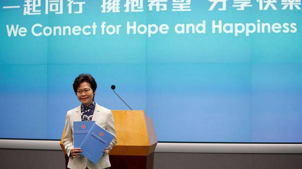 "Hong Kong's leader tinkers with economy in the face of ""grave"" challenges"