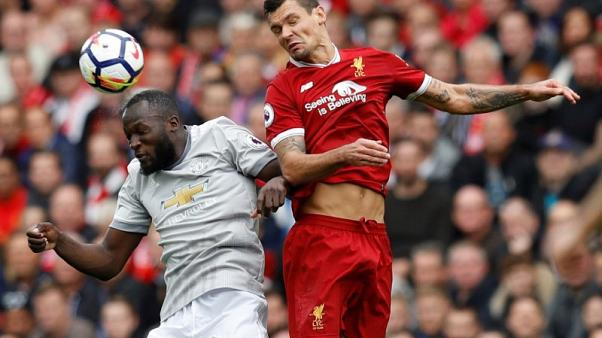 Liverpool's Lovren accuses Lukaku of deliberate kick to face
