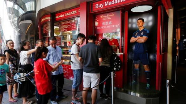 Madame Tussauds-owner Merlin blames attacks for dip in summer trade