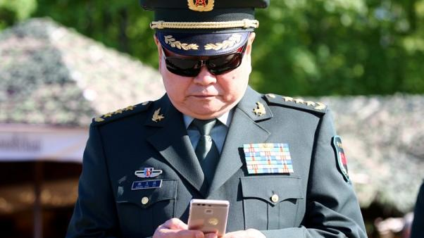 China combat veteran, close ally of Xi, to get promotion - sources