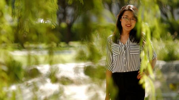 Young Chinese woman chases dream abroad, but looks wistfully home