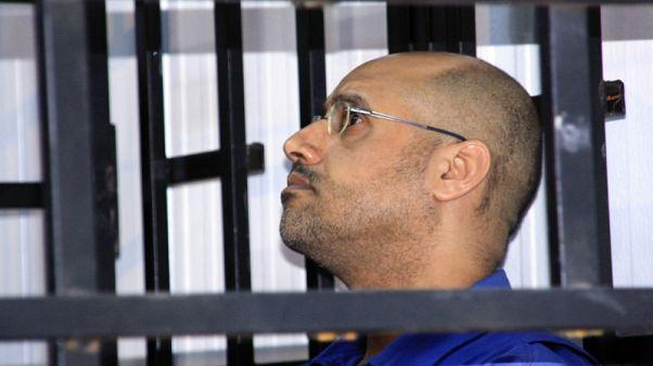 Gaddafi son in good health, following politics - family lawyer