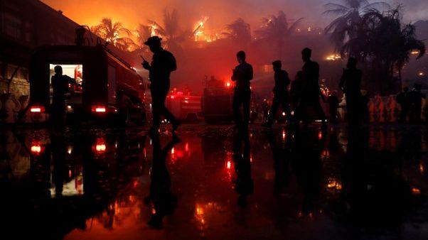 Fire destroys landmark hotel in Myanmar's largest city