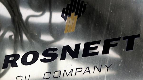 Russia's Rosneft CEO says oil market yet to rebalance
