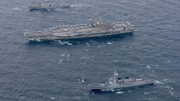 U.S. carrier patrols off Korean peninsula in warning to Pyongyang