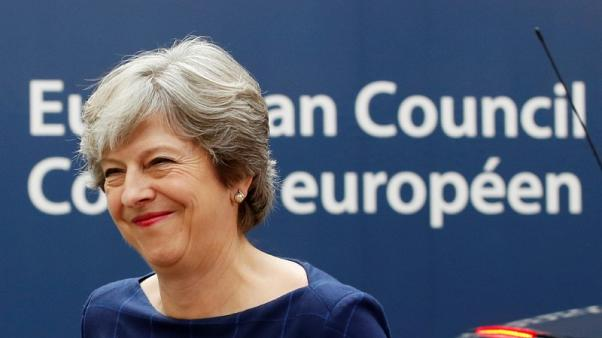 May calls for Brexit talks progress at EU summit