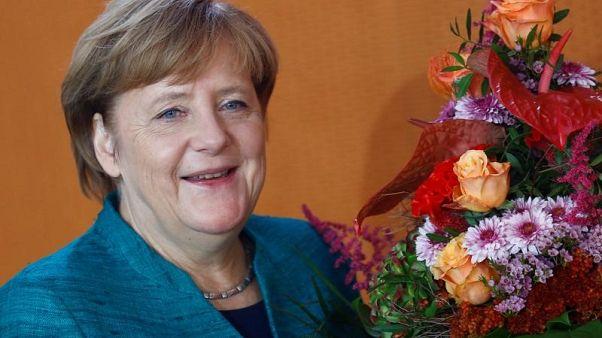Merkel praises Turkey on refugees, 'very worried' about rule of law