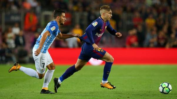 Soccer-Controversial Deulofeu goal helps Barca ease past Malaga
