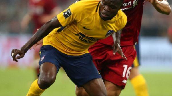 Gameiro strikes as Atletico keep Celta at bay in Vigo
