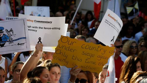 Protesters call for justice after Maltese journalist's killing