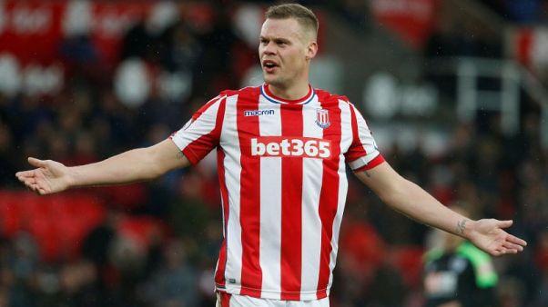 Blame players not Hughes for Stoke slump, says Shawcross