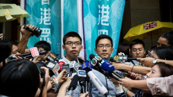 Hong Kong: les militants Joshua Wong et Nathan Law libérés sous caution