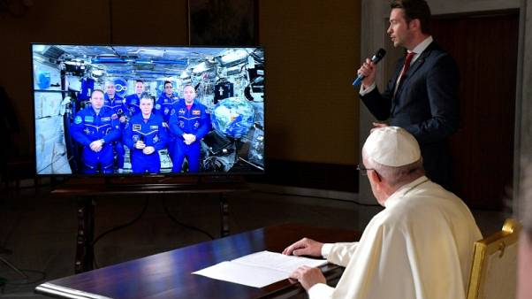 Earth is fragile, pope tells astronauts who see planet from 'eyes of God'