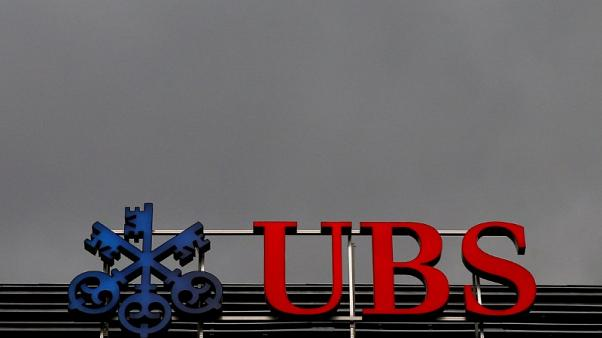 Swiss bank UBS posts 946 million Swiss francs in third quarter net profit, up 14 percent