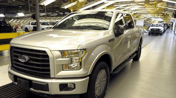 Wall Street loves electric cars, America loves trucks