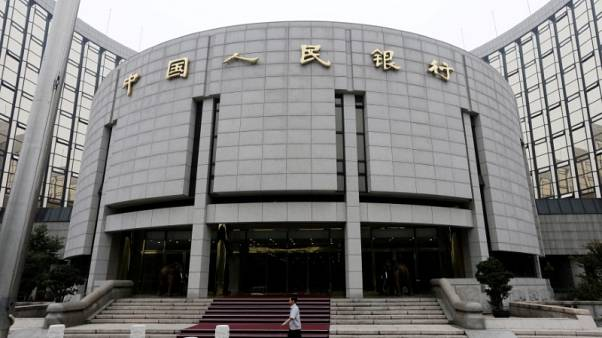 China central bank boosting oversight of loans offered on the internet - media