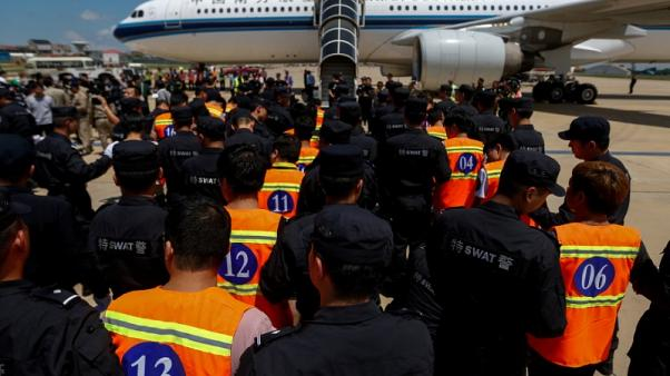 Cambodia deports 61 Chinese telecom extortion scam suspects