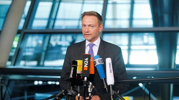 Germany's Free Democratic Party (FDP) leader, Christian Lindner, gives a statement as he arrives at the Reichstag building for exploratory talks about forming a new coalition government in Berlin, Germany, November 7, 2017. REUTERS/Hannibal Hanschke
