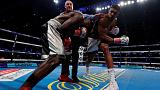 Boxing - Joshua stops Takam in 10th to retain heavyweight crowns