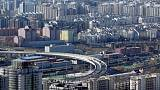 As China's home prices cool, some property companies seek to reduce risks