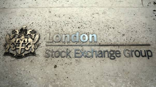 FILE PHOTO: A sign displays the crest and name of the London Stock Exchange in London, Britain August 15, 2017. REUTERS/Neil Hall/File Photo