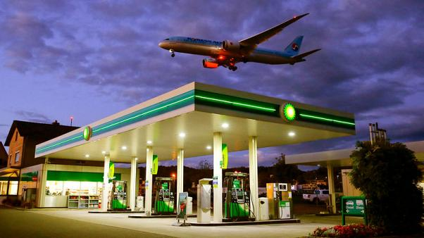 FILE PHOTO: An aircraft of Korean Airlines is seen above a BP petrol station approaching to land at Zurich Airport in Kloten, Switzerland October 3, 2017. REUTERS/Arnd Wiegmann/File Photo