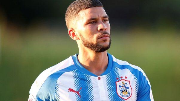 Dyche won't rush striker Wells into Burnley first team