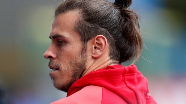 Bale strains muscle in yet another injury setback
