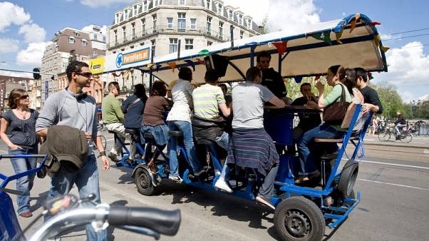 Last round for 'beer bikes' as Amsterdam curbs unruly tourists