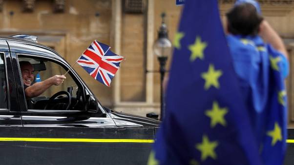 UK car execs tell PM May there is an 'urgent need' for clarity on Brexit transition