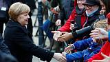 Germany records surge in refugees as Merkel seeks new migrant policy
