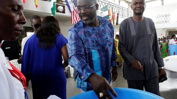 George Weah, former soccer player and presidential candidate of Congress for Democratic Change (CDC), is pictured at a church in Monrovia, Liberia October 8, 2017. Picture taken October 8, 2017. REUTERS/Thierry Gouegnon