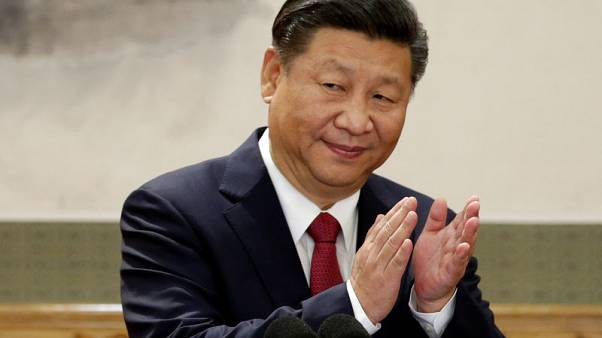 Promote peace, China's Xi tells soldiers at first overseas base