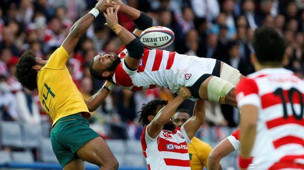 Rugby - Australia brush aside Japan 63-30 in Yokohama