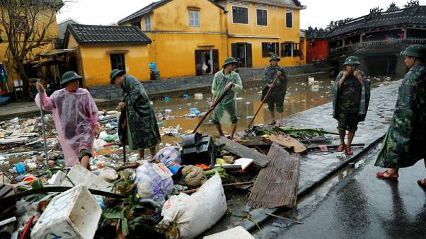 Vietnam soldiers clean debris caused by flooding by Typhoon Damrey in the ancient UNESCO heritage town of Hoi An, Vietnam November 8, 2017. REUTERS/Jorge Silva
